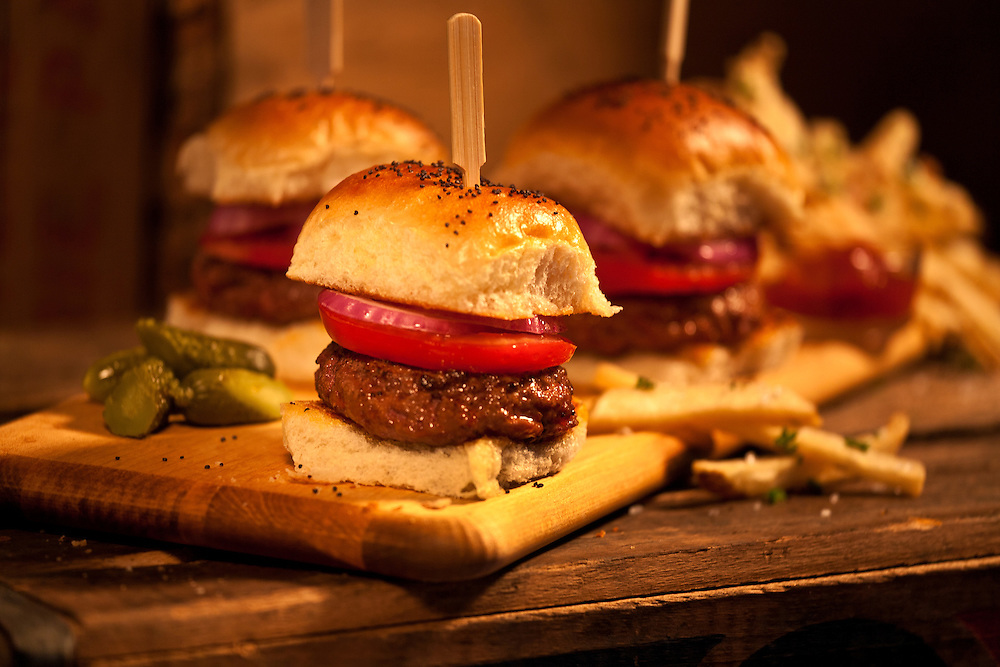 Burger Sliders on a cutting board on old soda crate,fries,horizontal