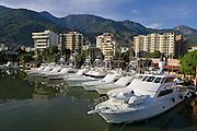 Fleet of traveling sportfishing boats lined up Med style at Venezuela's Marina Portofino.