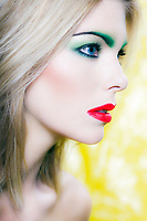 beautiful caucasian woman portrait beauty with colorful makeup studio on yellow background