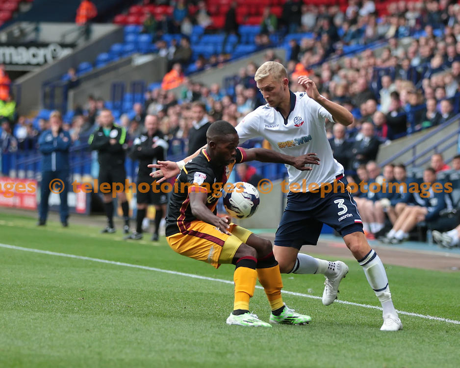 Bolton Wanderers defender Dean Moxey (3) and Bradford City midfielder Mark Marshall (7) vie for the ball during the Sky Bet League 1 match between Bolton Wanderers and Bradford City at the Macron Stadium in Bolton. September 24, 2016.<br /> Nigel Pitts-Drake / Telephoto Images<br /> +44 7967 642437