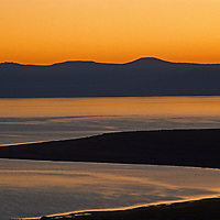 The sun rises over Mono Lake, a saline inland sea in the eastern Sierra Nevada of California. Its survival has been threatened by water diversions from its inlets made by the Los Angeles Department of Water & Power.