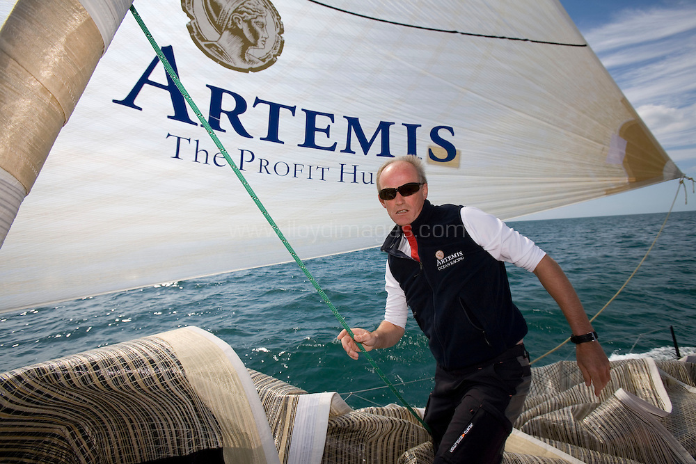 The Artemis Challenge at Skandia Cowes Week 2007. Cowes. Isle of Wight. A Fleet of Open 60 yachts race around the Isle of Wight as part of the IRC Class 0 big boat series..Picture shows a crew member onboard Artemis (an Open 60) racing for charity in the Artemis Challenge at Skandia Cowes Week. .Please credit all pictures: Roy Riley/LloydImages..E: hello@lloydimages.com.T: +44 7970798 011
