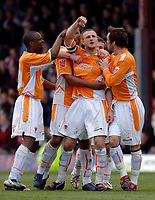 Photo: Daniel Hambury.<br />Brentford v Blackpool. Coca Cola League 1. 17/04/2006.<br />Blackpool's Peter Clarke (C) celebrates his goal with his team mates.