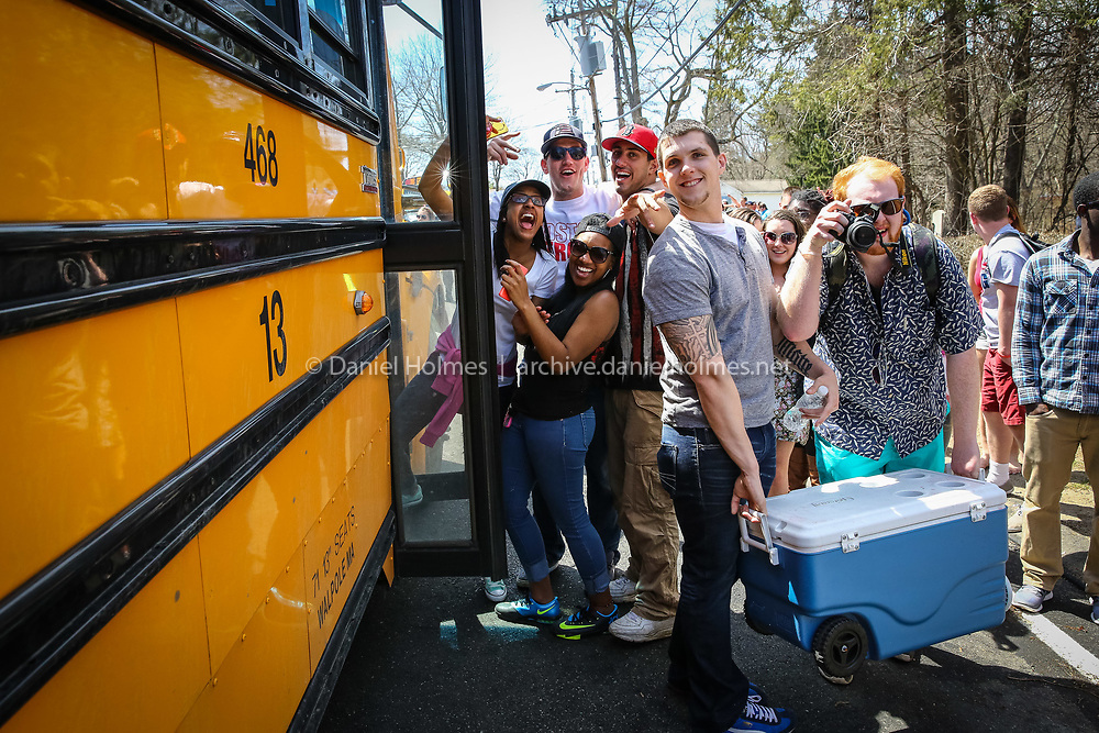 (4/21/14, ASHLAND, MA) At a home on Union St. (Rt. 135) near Main St. in Ashland, students are escorted by police to buses that will take them to Framingham State University after a party with over 200 people got out of control during the Boston Marathon on Monday. Daily News and Wicked Local Photo/Dan Holmes