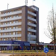 Phofiflat Huizen met een Nederlandse vlag in top
