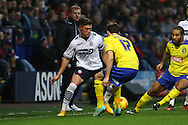Max Clayton of Bolton Wanderers looks to go past Jack Robinson of Huddersfield Town . Skybet football league championship match, Bolton Wanderers v Huddersfield Town at the Macron stadium in Bolton, Lancs on Saturday 29th November 2014.<br /> pic by Chris Stading, Andrew Orchard sports photography.
