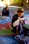 Boys in an Internally Displaced Persons Camp (IDP) called Zahri Dosht, outside of Kandahar, learn to read and write under tents.