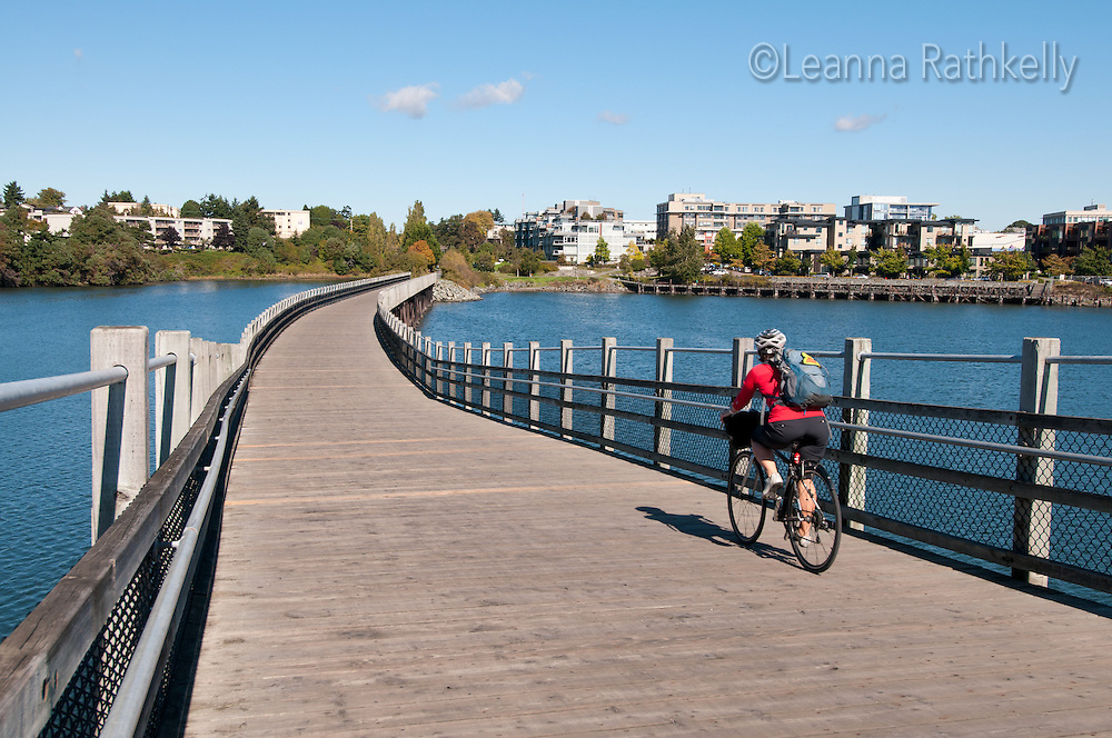 The Galloping Goose trail connects downtown Victoria to Sooke and other trails out to Sidney for use by cyclists and pedestrians. Here, cyclists ride the Selkirk Trestle Bridge over the Gorge waterway.