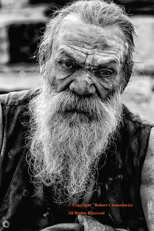 Red, Black and White (B&W): This aggressive Sadhu takes on a rather ominous persona given his white facial paint, white hair and beard, seen at the Karnatak State Ghat, Varanasi India.