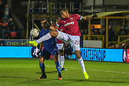 AFC Wimbledon striker Kweshi Appiah (9) battles for possession with West Ham United defender Issa Diop (23) during the The FA Cup match between AFC Wimbledon and West Ham United at the Cherry Red Records Stadium, Kingston, England on 26 January 2019.