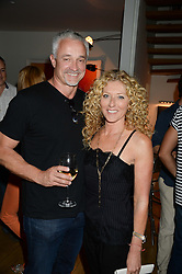 KELLY HOPPEN and JOHN GARDINER at an Evening with Notting Hill Guitars held at 167 Westbourne Grove, London W11 on 4th September 2013.