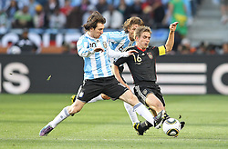 03.07.2010, CAPE TOWN, SOUTH AFRICA, ,Lionel Messi of Argentina attempts to tackle Philipp Lahm of Germany during the Quarter Final, Match 59 of the 2010 FIFA World Cup, Argentina vs Germany held at the Cape Town Stadium.EXPA Pictures © 2010, PhotoCredit: EXPA/ nph/  Kokenge