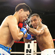 Zhankizh Turatov of Almaty, Kazakhstan (L) takes a glove to the face from Gustavo Garibay of Mexico during a Nelsons Promotions boxing match at the Boca Raton Resort  and Club on Friday, May 26, 2017 in Boca Raton, Florida.  (Alex Menendez via AP)