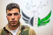 A member of the Free Syrian Army (FSA) pose for a picture at the FSA facilities in Marea on Monday, June 25, 2012. (Photo by Vudi Xhymshiti)