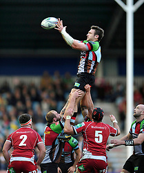 Harlequins replacement Tom Guest wins ball at a lineout - Photo mandatory by-line: Patrick Khachfe/JMP - Tel: Mobile: 07966 386802 12/10/2013 - SPORT - RUGBY UNION - Twickenham Stoop - London - Harlequins V Scarlets - Heineken Cup