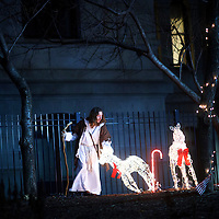 """Michael Grant, 28, """"Philly Jesus,"""" lifts a fallen Christmas decoration in the courtyard of Philadelphia City Hall in Philadelphia, PA.  Nearly everyday for the last 8 months, Grant has dressed as Jesus Christ, and walked the streets of Philadelphia to share the Christian gospel by example.  He quickly acquired the nickname of """"Philly Jesus,"""" which he has gone by ever since."""
