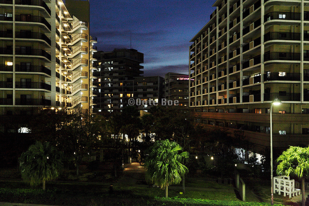 large apartment highrise complex at night