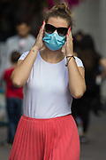 A shopper wears a face covering to help prevent the spread of the coronavirus on 20 September 2020 in Staines-Upon-Thames, United Kingdom. The Borough of Spelthorne, of which Staines-upon-Thames forms part along with Ashford, Sunbury-upon-Thames, Stanwell, Shepperton and Laleham, has been declared an 'area of concern' for COVID-19 by the government following a marked rise in coronavirus infections which is inconsistent with other areas of Surrey.