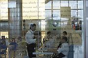 Waiters inside Carluccio's retail restaurant in landside Departures area of London Heathrow Airport's Terminal 5 building