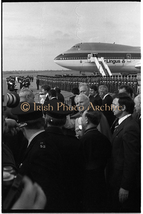 Pope John-Paul II visits Ireland..1979..29.09.1979..09.29.1979..29th September 1979..Today marked the historic arrival of Pope John-Paul II to Ireland. He is here on a three day visit to the country with a packed itinerary. He will celebrate mass today at a specially built altar in the Phoenix Park in Dublin. From Dublin he will travel to Drogheda by cavalcade. On the 30th he will host a youth rally in Galway and on the 1st Oct he will host a mass in Limerick prior to his departure from Shannon Airport to the U.S..Image of Pope John-Paul II as he waves to the crowd as he departs the airport for the short journey to The Phoenix Park, Dublin.