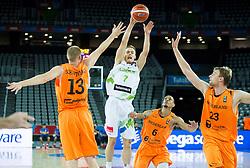 08-09-2015 CRO: FIBA Europe Eurobasket 2015 Slovenie - Nederland, Zagreb<br /> De Nederlandse basketballers hebben de kans om doorgang naar de knockoutfase op het EK basketbal te bereiken laten liggen. In een spannende wedstrijd werd nipt verloren van Slovenië: 81-74 / Klemen Prepelic of Slovenia vs Rowland Schaftenaar of Netherlands, Worthy de Jong of Netherlands and Henk Norel of Netherlands. Photo by Vid Ponikvar / RHF
