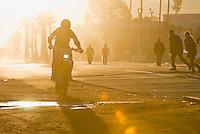 Class 30 motorcycle #305 of David Potts leaving the street at the start of 2007 Baja !000, Ensenada, Mexico