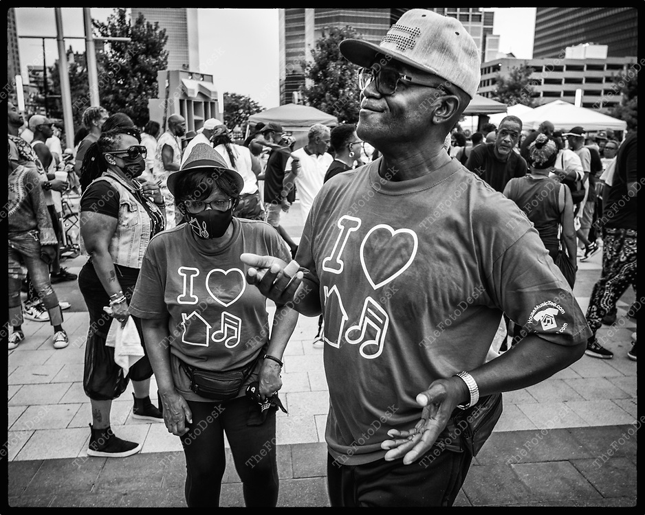 NEWARK, NEW JERSEY: A  couple wears house matching house music tees  the Bang The Drum House Music festival at Mulberry Commons in in Newark, NJ on Sunday, August 29, 2021. (Brian B Price/TheFotodesk).