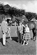 "08/08/1962<br /> 08/08/1962<br /> 08 August 1962 <br /> Dublin Horse show at the RDS, Ballsbridge, Dublin, Wednesday. Image shows John, Patrick and Mary O'Driscoll of Belvedere Stud, Donaghadee, Co. Down with her mothers 3 year old gelding ""Hypur"", winner of the Anthony Maude Cup at RDS Show."