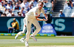 England's Stuart Broad fields from his own bowling delivery during the anthems during day one of the Ashes Test match at the Melbourne Circket Ground, Melbourne.