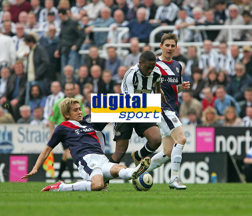 Photo: Andrew Unwin.<br />Newcastle United v West Bromwich Albion. The Barclays Premiership. 22/04/2006.<br />West Bromwich's Junichi Inamoto (L) looks to tackle Newcastle's Charles N'Zogbia (C).
