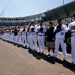 March 11, 2011; Fort Myers, FL, USA; Minnesota Twins second baseman Tsuyoshi Nishioka (1) and teammates stand for the national anthem prior to a  spring training exhibition game against the Boston Red Sox at Hammond Stadium.  Mandatory Credit: Derick E. Hingle-US PRESSWIRE