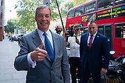 Brexit Party leader Nigel Farage gives a thumps up as he arrives to address party members and delegates at an event to introduce prospective parliamentary candidates in central London, United Kingdom on 27th August, 2019.