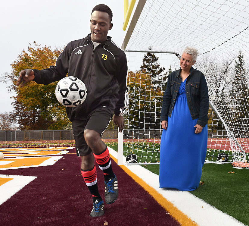 Mara Lavitt--Special to the Hartford Courant<br /> November 7, 2015 <br /> South Windsor varsity soccer player Daniel Eddy and his mother Barbara. Eddy, originally from Haiti, was adopted with his two sisters by Barbara two years ago.