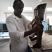 Disability Action Network (DAN) is based in Hargeisa in Somaliland and a charity working with disabled children and young people helping them to access health care and provide them with therapeutic rehabilitation. DAN supply and fit orthopaedic appliaces and physiotherapy when needed. Somaliland is a very poor country and to many not living in the capital Hargeisa health care is very difficult to come by..DAN received the STARS Foundation Health Award in 2008 for outstanding work. A specialist working for DAN is finishing off a leg prosthetic in their work shop in Hargeisa.