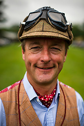 © Licensed to London News Pictures. 13/07/2015. Epsom, UK. Portrait of racer JONATHAN TURNER before the race. The start of The Royal Automobile Club 1000 Mile Trial 2015 at Woodcote Park in Epsom, Surrey. The event, which starts and finishes at Woodcote Park, takes a fleet of over 40 classic cars from around the world, through a 1000 mile trial around the UK.  Photo credit: Ben Cawthra/LNP