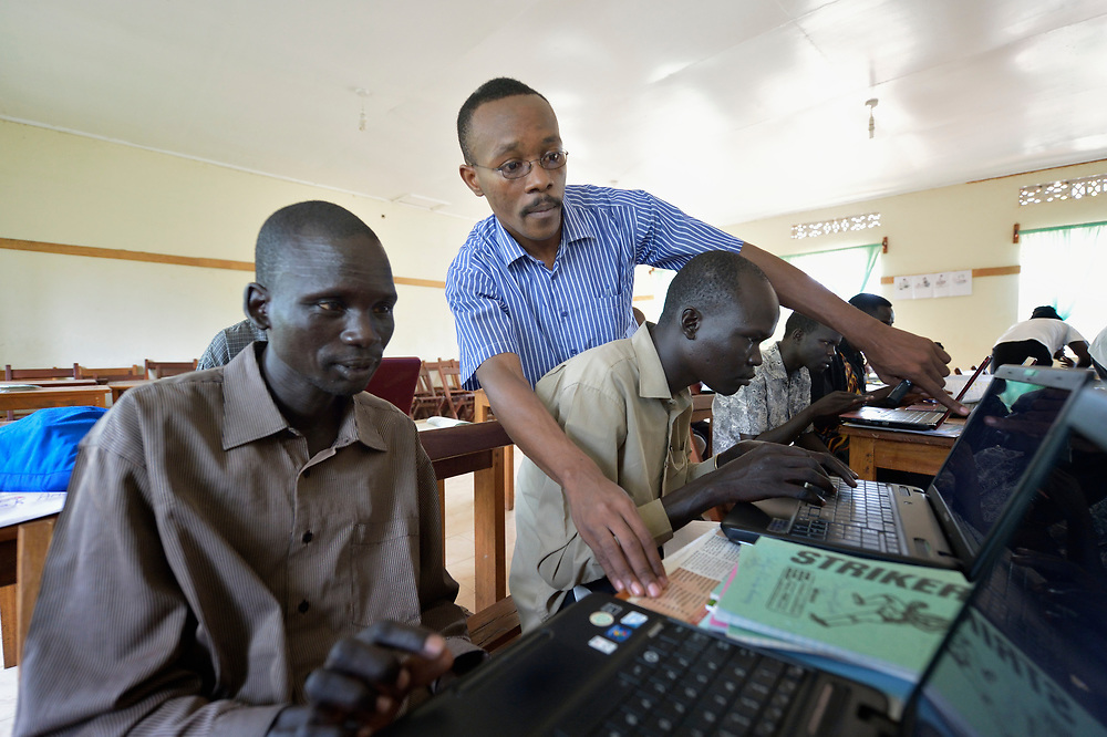 Julius Byaruhanga teaches a class at the Solidarity Teacher Training College in Yambio, South Sudan. Run by Solidarity with South Sudan, an international network of Catholic organizations supporting the development of the world's newest country, the College trains teachers from throughout the nation. Byaruhanga, a Ugandan, is a member of the Brothers of Christian Instruction.