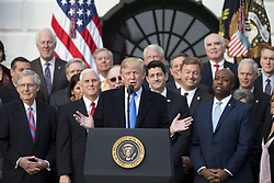 December 20, 2017 - Washington, District of Columbia, U.S. - United States President DONALD J. TRUMP speaks on the South Lawn of the White House surrounded by United States Vice President MIKE PENCE and Republican members of Congress after the United States Congress passed the Republican sponsored tax reform bill, the 'Tax Cuts and Jobs Act.' (Credit Image: © Alex Edelman/CNP via ZUMA Wire)
