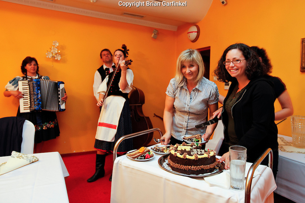 Kate cuts her birthday cake at dinner in Zilina, Slovakia on Friday July 1st 2011. (Photo by Brian Garfinkel)