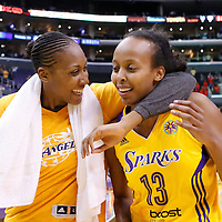 15 August 2014: Los Angeles Sparks forward/center Sandrine Gruda (7) celebrates with Los Angeles Sparks forward Farhiya Abdi (13) during the Los Angeles Sparks 77-65 victory over the Seattle Storm, at the Staples Center, Los Angeles, California, USA.