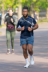 ©Licensed to London News Pictures 08/04/2020  <br /> Greenwich, UK. Runners in the park. People get out of the house from Coronavirus lockdown to exercise and enjoy the sunny weather in Greenwich park,Greenwich, London. Photo credit:Grant Falvey/LNP