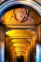 """""""Small Archangels - Papal Archbasilica of St. John in Lateran""""…<br /> <br /> Dedicated to St. John the Baptist and St. John the Evangelist, the Basilica of St. John Lateran is the first among the four major basilicas of Rome. It is also the Cathedral of the Bishop of Rome, the Pope, and is thus known as the """"Cathedral of Rome and of the World."""" Built by Constantine the Great in the 4th century, San Giovanni in Laterano was the first Christian/Catholic church erected in Rome. The present structure of the Basilica resembles Saint Peter's Basilica, and the ancient church was residence of the Papacy until the (1377) return from exile in Avignon and permanent relocation to the Vatican. Many Popes were responsible for repair and additions to the Basilica's overall splendor and importance throughout the last 1700 years. This image was inspired upon noticing dozens of tiny cherub angels holding up the archways of a long and narrow hallway leading to a sacred and Holy Door of the Archbasilica. Each angel is unique and has a different face and expression. One cannot help being overcome with humility observing the veneration of the Basilica's Piccoli Angeli protecting all the wondrous souls within."""