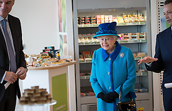 © Licensed to London News Pictures . 14/11/2013 . Manchester , UK . The Queen explores the canteen . Queen Elizabeth II and the Duke of Edinburgh visit the Coop building at 1 Angel Square , Manchester , this morning ( 14th November 2013 ) . Photo credit : Joel Goodman/LNP