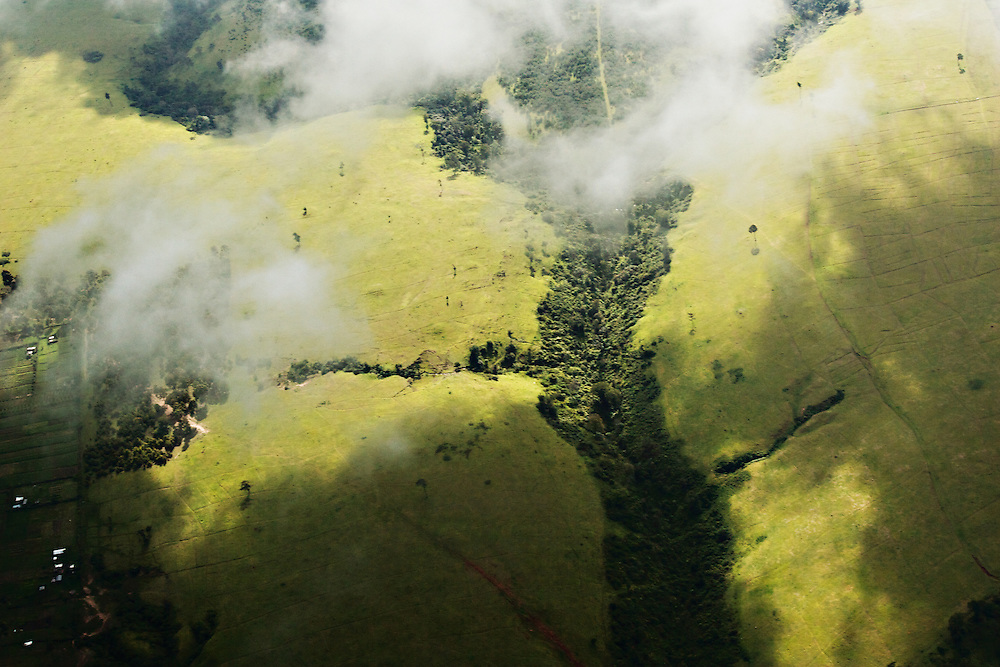 Aerial view of the Kenya's central highlands near Mt. Kenya, and one of the shallow ravines. This is a very fertile, intensively cultivated region northwest of Nairobi, year-round growing environment for cash crops such as tea, coffee, oranges, pineapples, and maize. However, soil erosion and deforestation claim ever increasing acres of land each year.