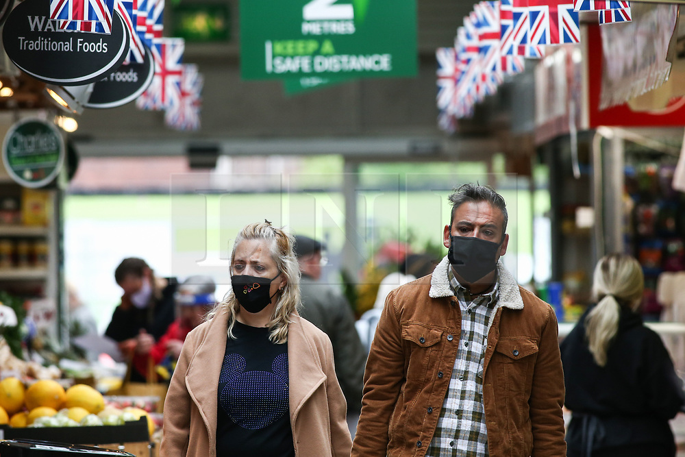 © Licensed to London News Pictures. 14/05/2021. Bolton, UK. Shoppers wear face masks at Bolton Market on Friday morning. Bolton now has the highest infection rate in Britain at 192.3 cases per 100,000. Photo credit: Adam Vaughan/LNP