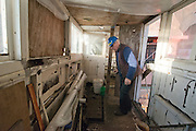 ****COPY HERE****  (https://www.dropbox.com/s/5mg81qiiuy22tre/adamson.rtf?dl=0)   © Licensed to London News Pictures. 02/12/2014. Liverpool , UK . Volunteer Graham Dean in the boathouse which has suffered vandalism when eh vessel was berthed at Ellesmere Port. The only surviving steam powered tug tender, the Daniel Adamson, is being completely renovated by a team of volunteers in Liverpool. The vessel, which has had 90,000 man hours already spent on it, was bought for only one pound is the awaiting the decision of the Heritage Lottery Fund on an application of £3.6m to bring her back to her full glory.  . Photo credit : Stephen Simpson/LNP<br /> <br /> COPY HERE https://www.dropbox.com/s/5mg81qiiuy22tre/adamson.rtf?dl=0