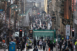 Glasgow, Scotland, UK. 11 December 2020. Covid-19 lockdown level 4 restrictions are lifted in Glasgow. Non essential businesses such as shops and restaurants can reopen from today. Pictured ; Buchanan Street much busier as shops re-opened. Iain Masterton/Alamy Live News