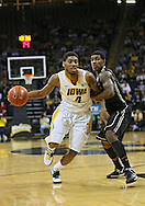 February 27 2013: Iowa Hawkeyes guard/forward Roy Devyn Marble (4) drives around Purdue Boilermakers guard Ronnie Johnson (3) during the first half of the NCAA basketball game between the Purdue Boilermakers and the Iowa Hawkeyes at Carver-Hawkeye Arena in Iowa City, Iowa on Wednesday, February 27 2013.