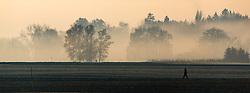 THEMENBILD - ein Mann spaziert auf einem Weg im Morgennebel, aufgenommen am 23. November 2016, Oberding in Bayern, Germany // A man walking on a path in the morning mist, Oberding, Bayern, Germany on 2016/11/23. EXPA Pictures © 2016, PhotoCredit: EXPA/ JFK