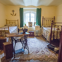 Restored boarding house bedroom at museum in Punta Arenas, Chile.