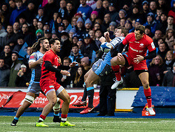 Garyn Smith of Cardiff Blues and Alex Goode of Saracens go for the high ball<br /> <br /> Photographer Simon King/Replay Images<br /> <br /> European Rugby Champions Cup Round 4 - Cardiff Blues v Saracens - Saturday 15th December 2018 - Cardiff Arms Park - Cardiff<br /> <br /> World Copyright © Replay Images . All rights reserved. info@replayimages.co.uk - http://replayimages.co.uk
